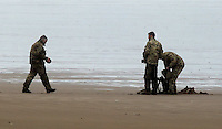 "Pictured: Bomb experts move the device at Cefn Sidan beach, near Pembrey west Wales, UK. Saturday 21 May 2016<br /> Re: A suspected bomb washed up on a Welsh beach has been detonated a bomb disposal unit after a walker came across it at Cefn Sidan beach, west Wales.<br /> After the discovery, the beach, aprt of Pembrey Country Park in Carmarthenshire , was cordoned off.<br /> The device was subsequently detonated.<br /> A spokesman for HM Coastguard Swansea said: ""The bomb disposal team is on the scene dealing with the object and it has just been detonated.""<br /> ""We will now be clearing up the debris and making sure the beach is clean and safe."""