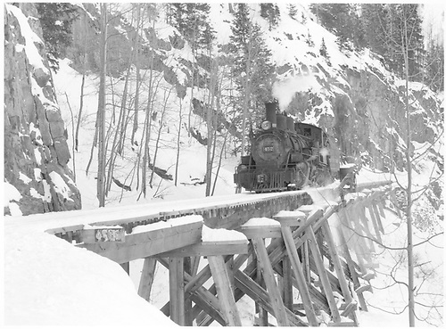 Almost head-on view of leased D&amp;RGW #452 northbound on Bridge 46-E on the Ophir High Line after acting as helper on freight.<br /> RGS  Ophir High Line, CO  Taken by Richardson, Robert W. - 11/19/1951