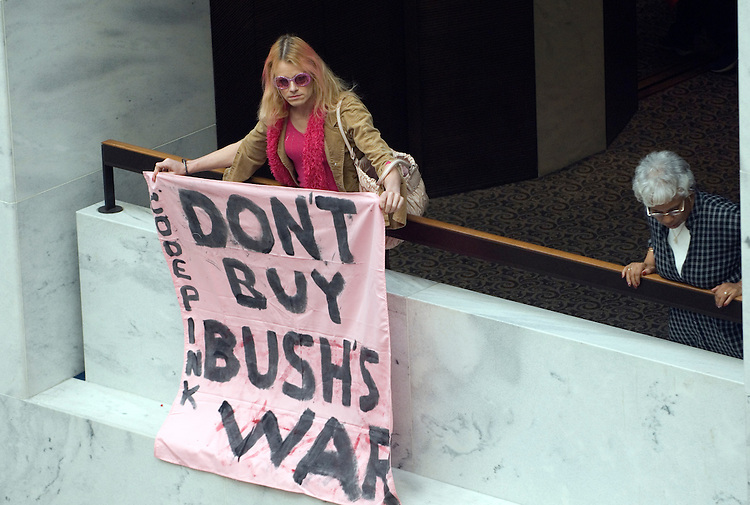 CODEPINK protesters staged an anti-war rally in the Hart Senate Office Building hanging banners, setting up a mock-graveyard and reading the names of the war dead. The protesters where arrested in mass by U.S. Capitol Hill Police.