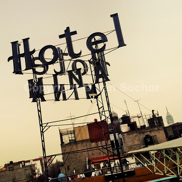 A turned off neon sign is seen on the roof of a low-budget hotel during the dusk in Mexico City, Mexico, 7 November 2014.