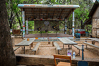 "Today Luckenbach maintains a ghost-town feel with its small population and strong western aesthetic. One of its two main buildings houses the remnants of a post office, a working saloon, and a general store. The other is the dance hall. The post office was closed on April 30, 1971 and its zip code (78647) was retired. The general store remains active as a souvenir shop where visitors can purchase a variety of items, including merchandise featuring the town's motto ""Everybody's Somebody in Luckenbach"", including postcards, T-shirts, sarcastic and humorous signs, and the local newspaper, the 8-page monthly Luckenbach Moon."