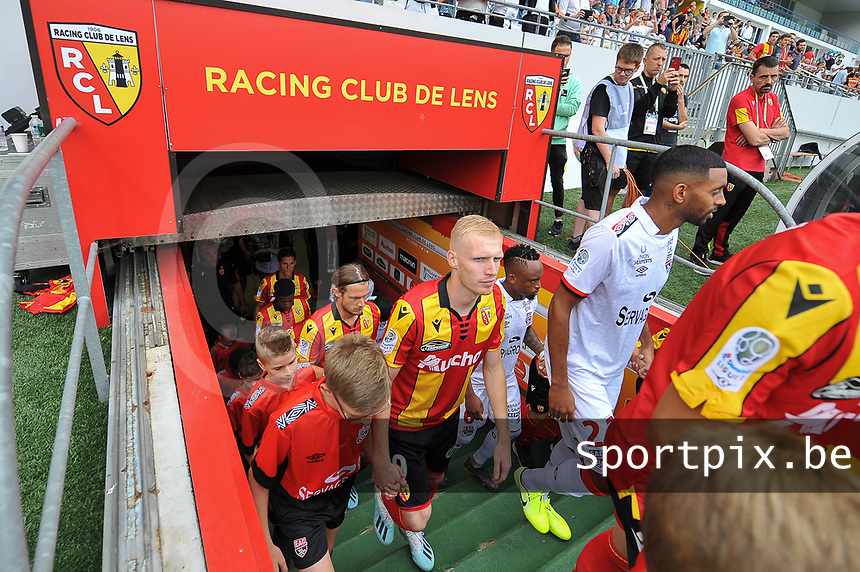 20190803 - LENS , FRANCE : illustration picture shows players entering the pitch with Gaetan Robail (M) and Guillaume Gillet (L) pictured during the soccer match between Racing Club de LENS and En Avant Guingamp , on the second matchday in the French Dominos pizza Ligue 2 at the Stade Bollaert Delelis stadium , Lens . Saturday 3 th August 2019 . PHOTO DIRK VUYLSTEKE | SPORTPIX.BE