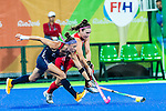 Michelle Kasold #18 of United States tackles the ball from Laura Unsworth #4 of Great Britain during Great Britain vs USA in a women's Pool B game at the Rio 2016 Olympics at the Olympic Hockey Centre in Rio de Janeiro, Brazil.
