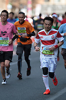 A runner dressed at Japanese rugby hero, Ayumu Goromaru during the 10th Tokyo Marathon took place on a fine spring day in Tokyo Japan. Sunday February 28th 2016. Thirty-six thousand runners took part with Ethiopian,  Feyisa Lilesa winning the  men's competition and  Kenyan, Helah Kiprop victorious in the women's race.