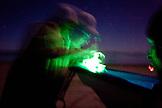 MEXICO, Baja, Magdalena Bay, Pacific Ocean, fixing the boat at night near Magdalena Bay