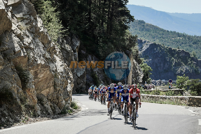 The peloton led by Deceuninck-Quick Step climb Col de Vars during Stage 18 of the 2019 Tour de France running 208km from Embrun to Valloire, France. 25th July 2019.<br /> Picture: ASO/Pauline Ballet | Cyclefile<br /> All photos usage must carry mandatory copyright credit (© Cyclefile | ASO/Pauline Ballet)