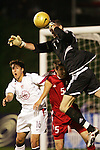 22 January 2006: Canadian goalkeeper Greg Sutton (right) claims the ball in the penalty area as teammate Marco Reda (5) battles to keep US forward Josh Wolff (16) away from the cross. The United States Men's National Team tied Canada 0-0 at Torero Stadium in San Diego, California in an International Friendly soccer match.