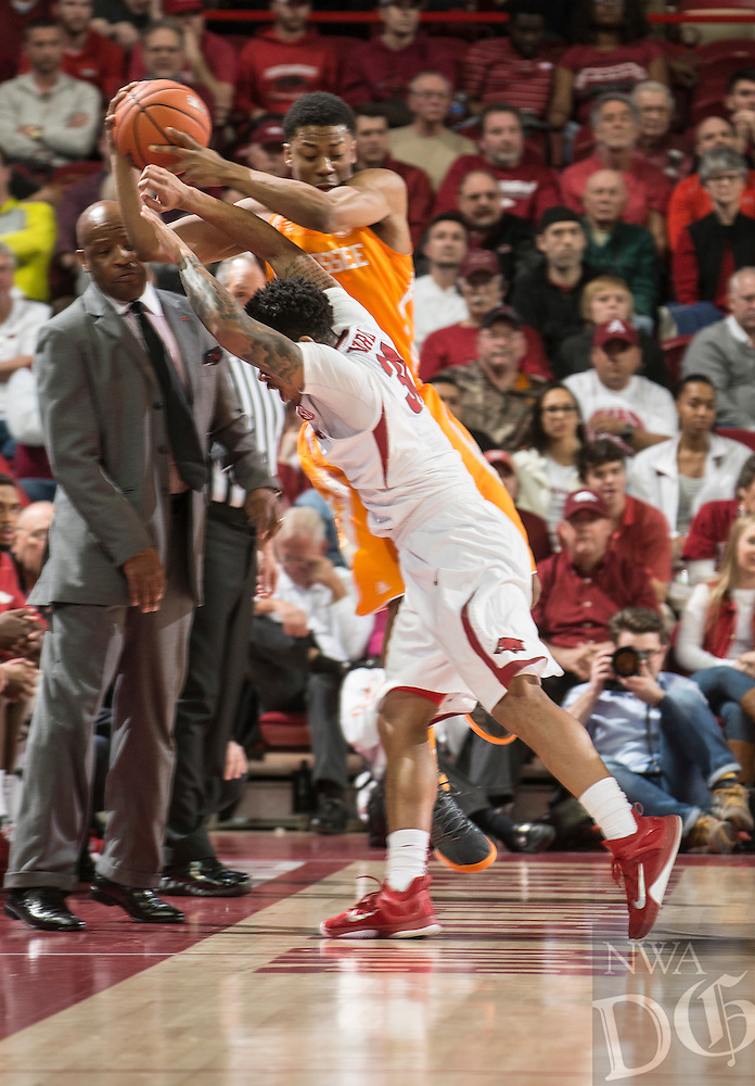 NWA Democrat-Gazette/ANTHONY REYES • @NWATONYR<br /> Anton Beard, Arkansas freshman, fights with Robert Hubbs, Tennesse Sophomore, for the ball in the first half Tuesday Jan. 27, 2015 at Bud Walton Arena in Fayetteville.