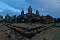 The East Mebon a 10th Century temple at Angkor, Cambodia. Built during the reign of King Rajendravarman, Interesting are the carved standing Elephants on the corners. Cambodia