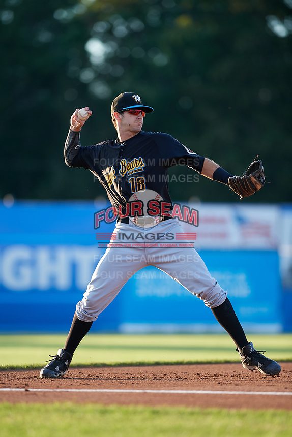 West Virginia Black Bears third baseman Dylan Busby (18) throws to first base during a game against the Batavia Muckdogs on August 5, 2017 at Dwyer Stadium in Batavia, New York.  Batavia defeated Williamsport 3-2.  (Mike Janes/Four Seam Images)