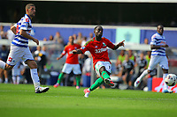 FAO SPORTS PICTURE DESK<br /> Pictured: Nathan Dyer of Swansea (R) scoring his first goal, the third of the game. Saturday 18 August 2012<br /> Re: Barclay's Premier League, Queens Park Rangers v Swansea City FC at Loftus Road Stadium, London, UK.