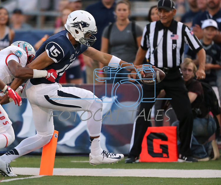Nevada quarterback Tyler Stewart rushes for a touchdown against New Mexico's Daniel Henry during the second half at an NCAA college football game in Reno, Nev., on Saturday, Oct. 10, 2015. Nevada won 35-17. (AP Photo/Cathleen Allison)