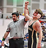 Thomas Rohan of Wantagh, right, raises his arm in triumph after defeating Nick Belitsis of Great Neck South at 145 pounds in the Nassau County Divsision I varsity wrestling quarterfinals at Hofstra University on Saturday, Feb. 11, 2017. Trailing 5-4 with less than 10 seconds left in the match, Rohan scored a two-point reveral and tacked on three additional points in the final moments to win by decision 9-5.