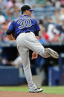 Colorado Rockies pitcher Josh Roenickke #30 delivers a pitch during a game against the Atlanta Braves at Turner Field on September 3, 2012 in Atlanta, Georgia. The Braves  defeated the Rockies 6-1. (Tony Farlow/Four Seam Images).