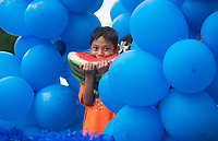 NWA Democrat-Gazette/BEN GOFF @NWABENGOFF<br /> Markus Hermon, 6, rides on the High Performance Nutrition float Friday, May 25, 2018, during the opening ceremony for the 39th annual Republic of the Marshall Islands Jemenei (Constitution) Day celebration at the Jones Center in Springdale. The celebration continues Saturday with basketball, baseball and other sporting events.