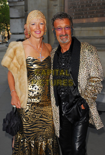 EDDIE JORDAN & WIFE.The Biba Ball at the Victoria & Albert Museum, London, UK..May 11th, 2006.Ref: CAN.half length gold black dress pattern animal print married husband.www.capitalpictures.com.sales@capitalpictures.com.©Capital Pictures