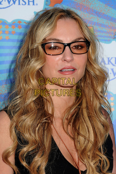 DREA DE MATTEO .At the Make-A-Wish Foundation Day held at the Santa Monica Pier, Santa Monica, California, USA, .14th March 2010..portrait headshot black top glasses .CAP/ADM/BP.©Byron Purvis/Admedia/Capital Pictures