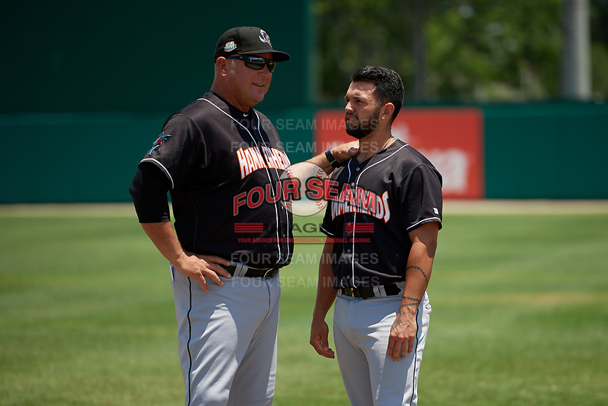 Jupiter Hammerheads manager Todd Pratt (54) talks with Michael Hernandez (6) before a Florida State League game against the Dunedin Blue Jays on May 16, 2019 at Jack Russell Memorial Stadium in Clearwater, Florida.  Dunedin defeated Jupiter 1-0.  (Mike Janes/Four Seam Images)