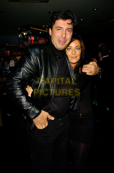 JEAN-CHRISTOPHE NOVELLI & PARTNER.Jean-Christophe Novelli's Findus Food Range Launch, Absolut Ice Bar, London, UK..January 24th, 2007.half length Jean Christophe black leather jacket couple .CAP/CAN.©Can Nguyen/Capital Pictures