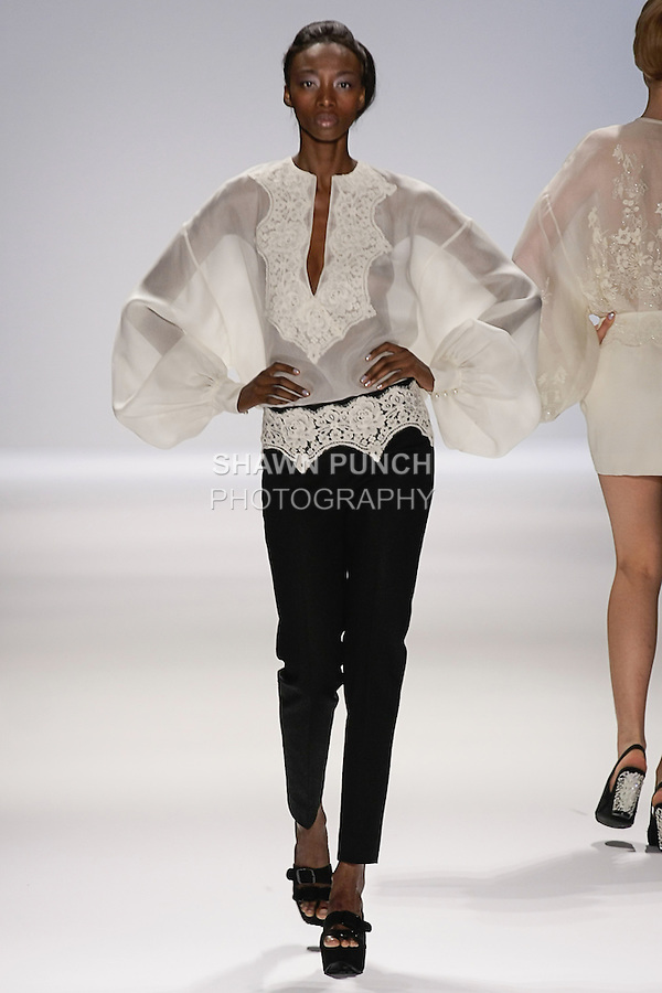 Model walks runway in an outfit from the Zang Toi Spring 2013 collection, during Mercedes-Benz Fashion Week Spring 2013 at Lincoln Center.