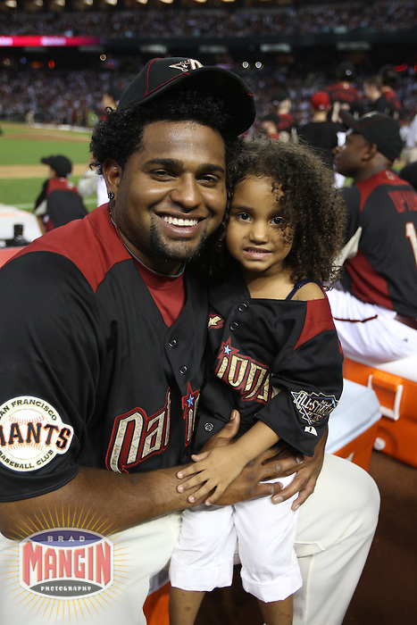 PHOENIX - JULY 11:  Pablo Sandoval poses for a picture with his daughter Yoleadny Sandoval during the 2011 MLB Home Run Derby at Chase Field on July 11, 2011 in Phoenix, Arizona. Photo by Brad Mangin