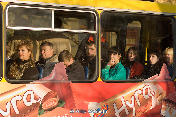 Passengers in a bus in Lviv.