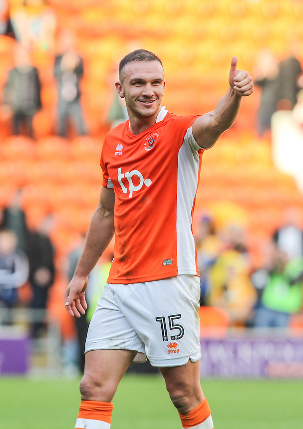 Blackpool's Tom Aldred gives the thumbs up to supporters after the final whistle<br /> <br /> Photographer Alex Dodd/CameraSport<br /> <br /> The EFL Sky Bet League Two - Blackpool v Cambridge United - Saturday 8th October 2016 - Bloomfield Road - Blackpool<br /> <br /> World Copyright &copy; 2016 CameraSport. All rights reserved. 43 Linden Ave. Countesthorpe. Leicester. England. LE8 5PG - Tel: +44 (0) 116 277 4147 - admin@camerasport.com - www.camerasport.com