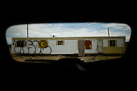Travel scenes of Wyoming through the window of a rented Mazda M5...An empty trailer home at an exit off Interstate 80 east of Sinclair, Wyoming.