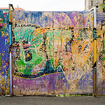 Panels with Graffiti art along the street used as a barrier to hide a stalled construction site, Belgrade, Serbia