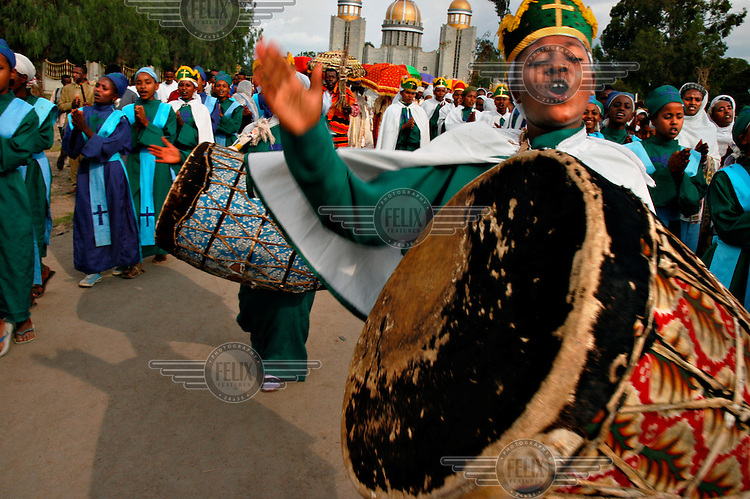 A man plays a huge drum as a part of the celebration of the Meskal, an annual religious holiday commemorating the discovery of the True Cross. The festival is known as Feast of the Exaltation of the Holy Cross. .