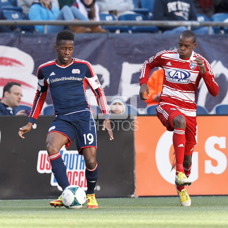 New England Revolution midfielder Clyde Simms (19) passes the ball as FC Dallas midfielder Jackson Goncalves (6) closes..  In a Major League Soccer (MLS) match, FC Dallas (red) defeated the New England Revolution (blue), 1-0, at Gillette Stadium on March 30, 2013.