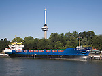 Cargo ship 'DC Merwestone' moored by Euromast tower,  Port of Rotterdam, Netherlands