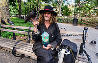 New York, NY 10 August 2010 - Larry the Birdman Reddick with Cesare, one of the many pigeons of Washington Square Park