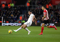 Pictured L-R: Neil Taylor of Swansea against Dusan Tadic of Southampton Sunday 01 February 2015<br />