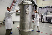 Physicist Igor Bolshinsky and project leader Kelly Cummins inspect a cask containing highly enriched uranium (HEU) at the Institute of Nuclear Physics in Almaty. Bolshinsky points at an IAEA (International Atomic Energy Agency) seal that verifies the authenticity of the nuclear shipment. The removal of Kazakhstan's HEU is part of the U.S. Global Threat Reduction Initiative (GTRI), where Bolshinsky and Cummins work, which tries to secure nuclear material around the world to prevent their misuse.