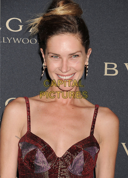 WEST HOLLYWOOD, CA- FEBRUARY 25: Model Erin Wasson arrives at the BVLGARI 'Decades Of Glamour' Oscar Party Hosted By Naomi Watts at Soho House on February 25, 2014 in West Hollywood, California.<br /> CAP/ROT/TM<br /> &copy;Tony Michaels/Roth Stock/Capital Pictures