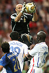09 July 2006: Goalkeeper Fabien Barthez (FRA) (top) claims the ball in the penalty area. Italy tied France 1-1 in overtime at the Olympiastadion in Berlin, Germany in match 64, the championship game, of the 2006 FIFA World Cup Finals. Italy won the World Cup by defeating France 5-3 on penalty kicks.