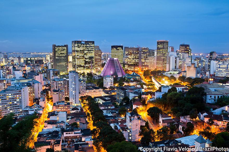 Downtown Rio de Janeiro seen from Santa Teresa neighborhood at dusk,  Metropolitan Cathedral of Rio de Janeiro with its conical form in the center.