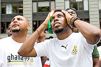 Ghana fans watch their team during a World Cup match against the United States on June 22, 2006 on a large outdoor Jumbo Tron at Times Square in New York City.<br /> <br /> The World Cup, held every four years in different locales, is the world's pre-eminent sports tournament in the world's most popular sport, soccer (or football, as most of the world calls it).  Qualification for the World Cup is open to any country with a national team accredited by FIFA, world soccer's governing body. The first World Cup, organized by FIFA in response to the popularity of the first Olympic Games' soccer tournaments, was held in 1930 in Uruguay and was participated in by 13 nations.    <br /> <br /> As of 2010 there are 208 such teams.  The final field of the World Cup is narrowed down to 32 national teams in the three years preceding the tournament, with each region of the world allotted a specific number of spots.  <br /> <br /> The World Cup is the most widely regularly watched event in the world, with soccer teams being a source of national pride.  In most nations, the whole country is at a standstill when their team is playing in the tournament, everyone's eyes glued to their televisions or their ears to the radio, to see if their team will prevail.  While the United States in general is a conspicuous exception to the grip of World Cup fever there is one city that is a rather large exception to that rule.  In New York City, the most diverse city in a nation of immigrants, the melting pot that is America is on full display as fans of all nations gather in all possible venues to watch their teams and celebrate where they have come from.