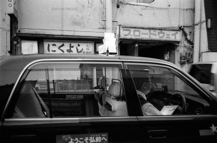 A taxi in a street in Hirosaki.