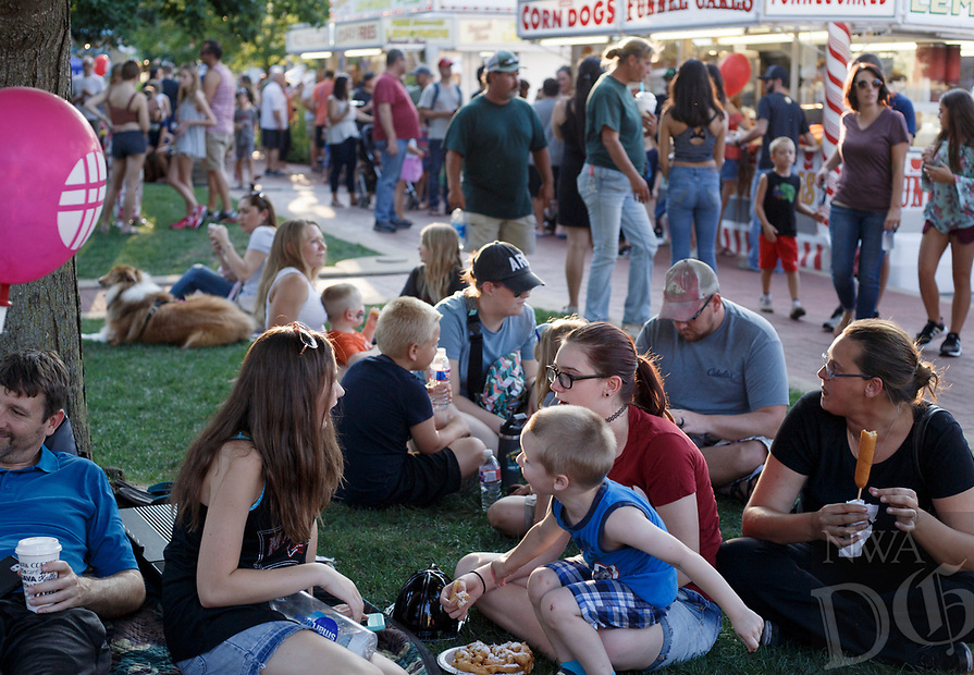 NWA Democrat-Gazette/CHARLIE KAIJO Visitors pack the grounds of the Bentonville Square during the First Friday event, Friday, August 3, 2018 in Bentonville.