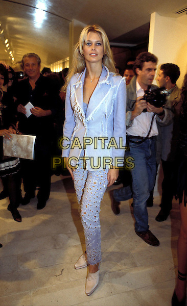 CLAUDIA SCHIFFER.Ref:CAP/OME.german supermodel, pale blue torn ripped denim trouser suit, full length, full-length.www.capitalpictures.com.sales@capitalpictures.com.© Capital Pictures