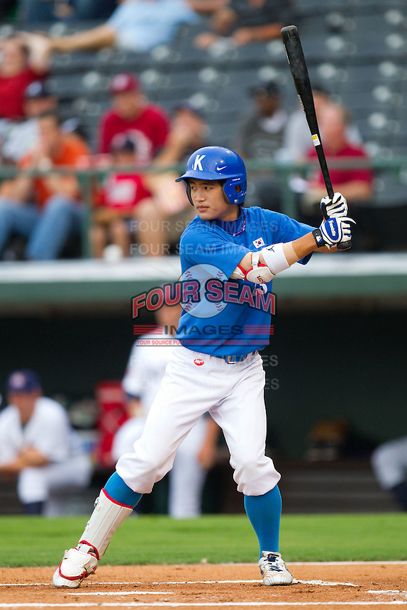 Min-Sik Kim #23 of Team Korea at bat against Team USA at Knights Stadium July 16, 2010, in Fort Mill, South Carolina.  Photo by Brian Westerholt / Four Seam Images