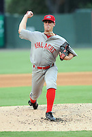 Pitcher Keith Couch (19) of the Greenville Drive, Class A affiliate of the Boston Red Sox, in a game against the Charleston RiverDogs on July 31, 2011, at Fluor Field at the West End in Greenville, South Carolina. The Drive wore throwback jerseys honoring the textile mill baseball teams. (Tom Priddy/Four Seam Images)