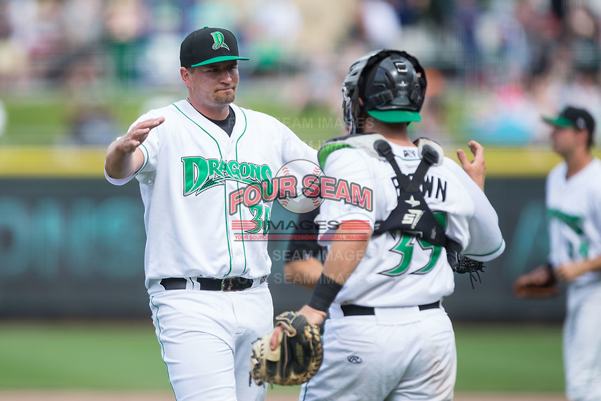 Dayton Dragons relief pitcher Joel Kuhnel (36) is congratulated by catcher Cassidy Brown (39) after closing out the win over the West Michigan Whitecaps at Fifth Third Field on May 29, 2017 in Dayton, Ohio.  The Dragons defeated the Whitecaps 4-2.  (Brian Westerholt/Four Seam Images)
