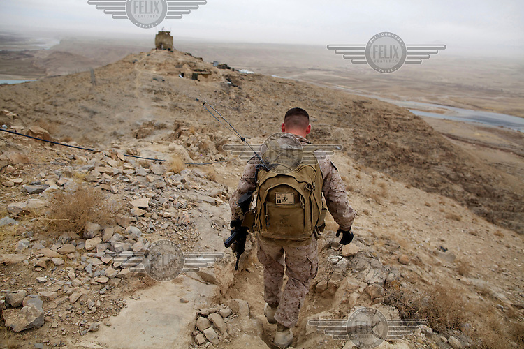 US Army Captain Jonathan Glover from Bravo Company, 1 Marine Division, 10th Company, on his way to Sparrowhawk West Observation Post, from FOB Zeebrugge near Kajaki Dam.