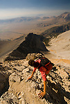 "A young woman climbs down from ""Chicken Out Ridge"" on Borah Peak in the Lost River Range, Idaho."