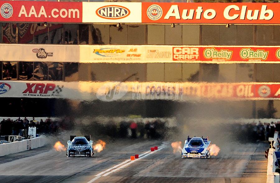 Feb. 27, 2011; Pomona, CA, USA; NHRA funny car driver Robert Hight (right) defeats Matt Hagan in the final round to win the Winternationals at Auto Club Raceway at Pomona. Mandatory Credit: Mark J. Rebilas-