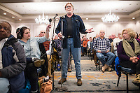 "Dr. Twig Johnson, of Kingston, Mass., speaks at a public hearing regarding Pilgrim Station, a nuclear power plant run by Entergy, at Hotel 1620 in Plymouth, Massachusetts, USA, on Tues., Jan. 31, 2017. Johnson expressed his concerns about the safety of the plant. An email from the NRC was leaked in December 2016 outlining problems with the ""safety culture"" at the plant and an ""overwhelmed"" staff. Area residents have been calling for the plant to be shut down. The green signs in the audience, reading ""Shut Pilgrim Now,"" are from a group of area residents calling for the plant's closure called Cape Downwinders."