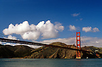 Golden Gate Bridge San Francisco Bay, low angle looking up. The Golden Gate connects San Francisco penninsula and Marin penninsula and is nearly two miles long,  San Francisco, California USA